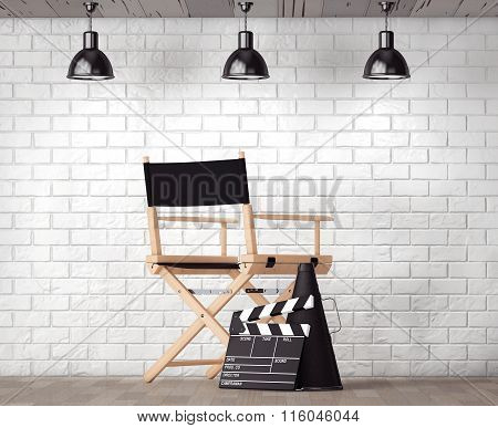 Director Chair, Movie Clapper And Megaphone In Front Of Brick Wall With Blank Frame