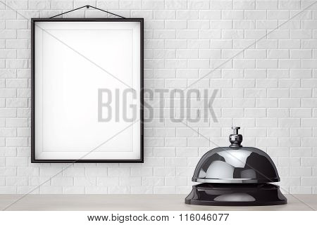 Service Bell Ring In Front Of Brick Wall With Blank Frame