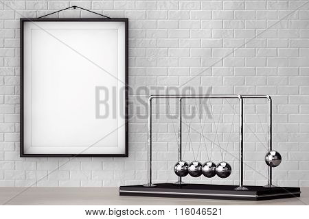 Spheres Of Newton In Front Of Brick Wall With Blank Frame