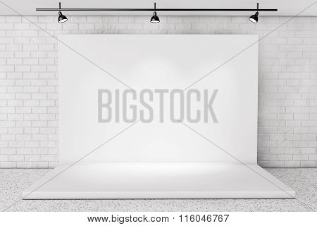 White Backdrop Stage In Room With Brick Wall