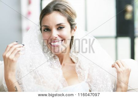 Young sexy romantic latin bride in erotic lingerie smiling