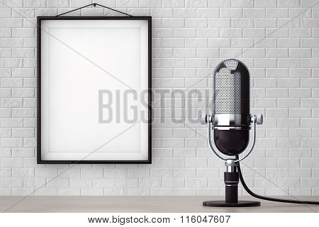Vintage Silver Microphone In Front Of Brick Wall With Blank Frame