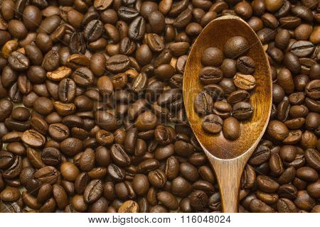 Lacquer Wooden Spoon On Coffee Beans Background