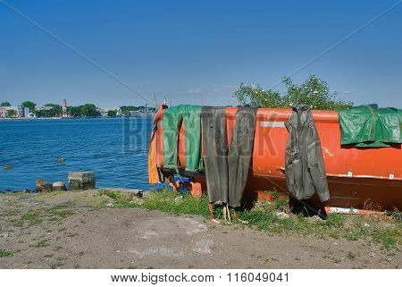 Fishing boat with wet sailor uniform. Baltiysk