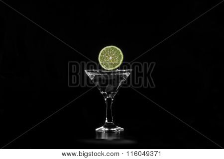 Slice Of Lime Water Dropped Into A Glass