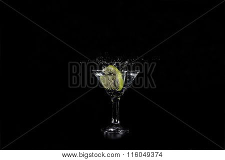 Slice Of Lime Water Into A Glass