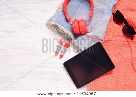 Young Woman's Outfit On White Wooden Background.