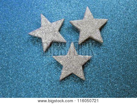 Three Stars On Illuminated Background