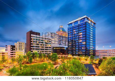 Greensboro, North Carolina, USA downtown city park and skyline.