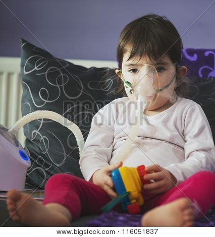 Girl Making Inhalation With Mask On Her Face
