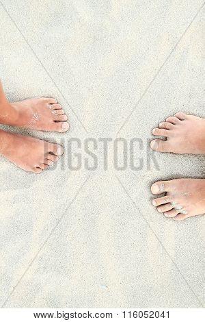 Couple Of Love  Feet On The Sand On The Beach