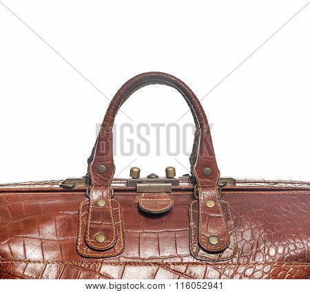 Handles brown bag.