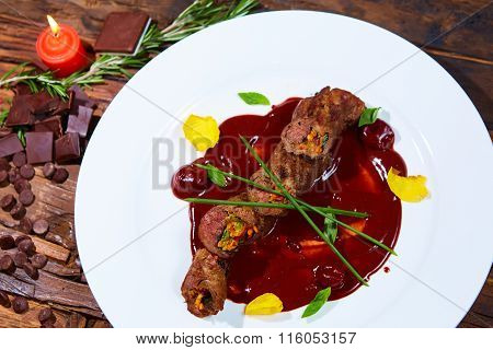 Roasted meat with vegetables and chocolate sauce