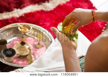 Traditional Indian Hindu religious praying items in ear piercing ceremony for children. Focus on the turmeric spice. India special rituals heritage.
