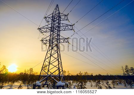 Line Of Electricity Transmission In The Winter At Sunset.