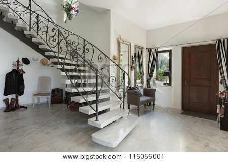 House, Interior with staircase in large hall with marble floor