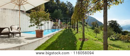 Architecture, modern house with pool, view from the garden