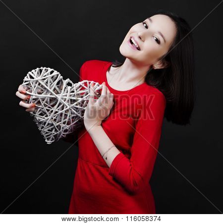 happy teenage girl with a heart in her hands, Valentine's day topic