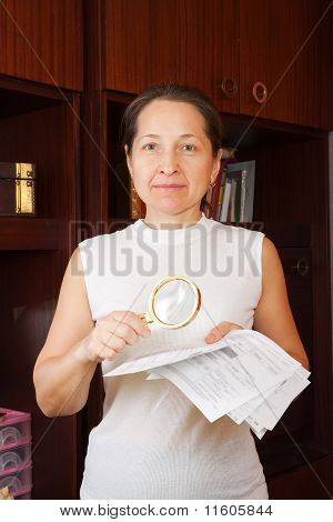 Mature Woman Looking At Utility Bills