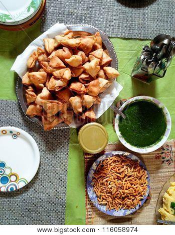 Indian snacks of Samosa, chutney and namkeen