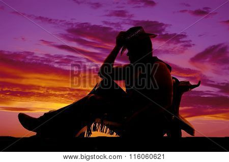 Silhouette Of Cowboy Sit Lean On Saddle Knees Up
