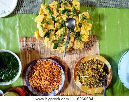 Indian dish of Dhokla, namkeen and chutney