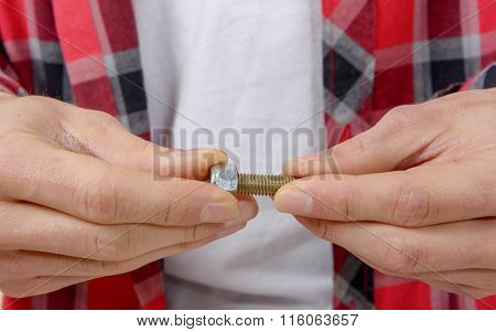Close-up Hands Of A Technician Screwing A Bolt