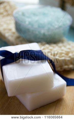 Natural Organic Soap Sea Salt Organic Loofah  On A Blue Wooden