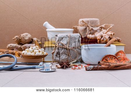 Alternative Health Care Lotus Seed In Wooden Spoon Put On Dried Various Chinese Herbs In Wooden Box