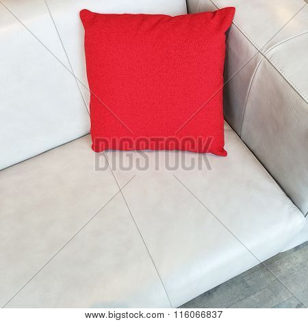 Gray Leather Sofa With Red Cushion