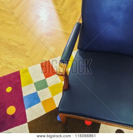 Blue Leather Armchair On Colorful Rug