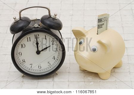 Time To Start Saving, A Piggy Bank And Alarm Clock On Stone Background
