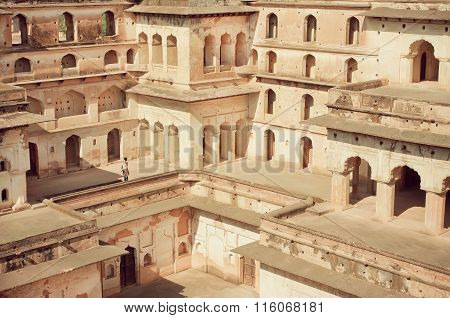 Figure Of A Tourist In Maze Of Levels In Historical Structure Of Fortress Jahangir Mahal.