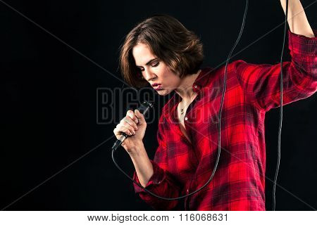 Model Red Flannel Shirt Singing Into Mic