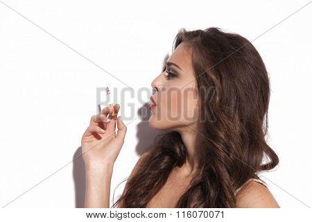 profile of woman with cigarette studio shot closeup