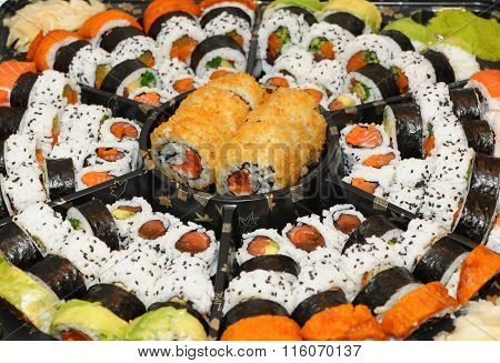 many sushi pieces on a tray