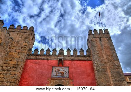 The front of the main entrance gate to Real Alcazar Gardens in Seville. Andalusia Spain in HDR