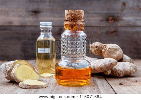 Alternative Medicine And Nature Spas Ingredients - Ginger Root And Ginger Essential Oil Set Up On Ol