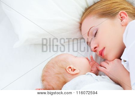 Newborn Baby And Mother Sleeping Together