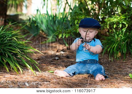 Baby Boy Playing With Sticks