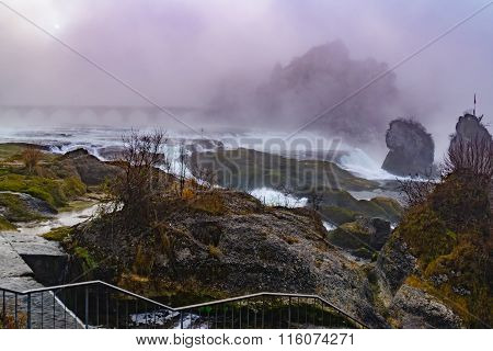 The Rhine Falls In A Foggy Day. Switzerland