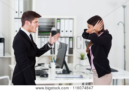 Boss Yelling At Secretary Covering Ears