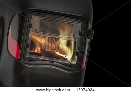 Reflection Of The Flame In The Glass Protective Mask, Isolated On Black Background