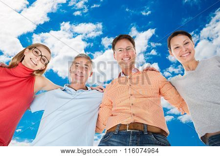 Two Happy Couples Looking Down