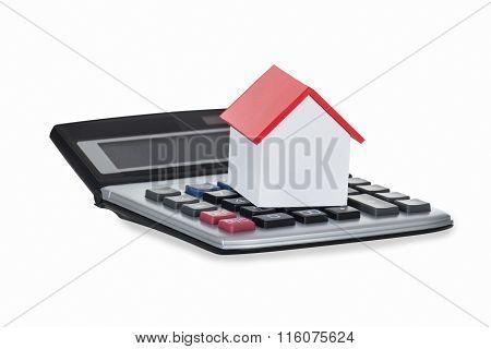 Closeup Of House Model And Calculator