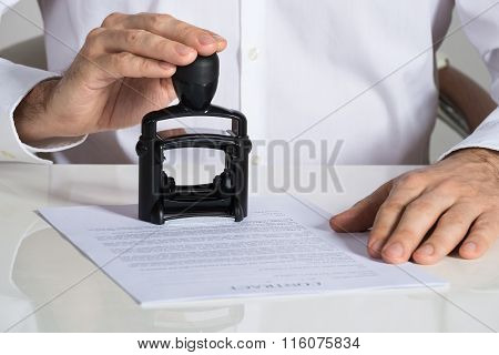 Businessman Stamping Contract Document