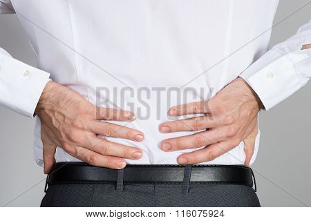 Rear View Of Businessman Suffering From Back Ache