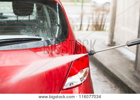 Car Being Washed With High Pressure Water Jet
