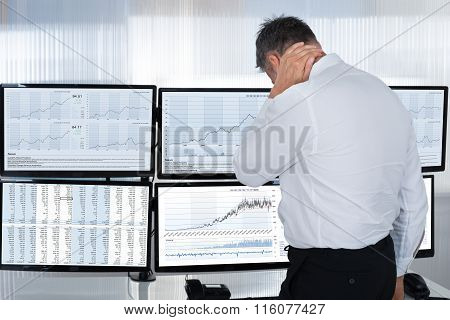 Stock Market Broker Suffering From Neck Pain By Multiple Screens