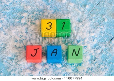 Calendar date on color wooden cubes with marked Date of 31st Of January